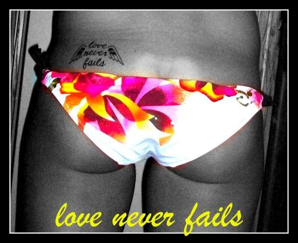 Love Never Fails tattoo