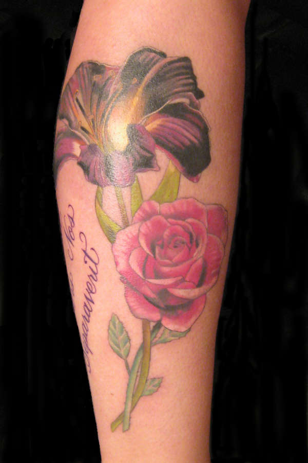 A lily and a rose tattoo