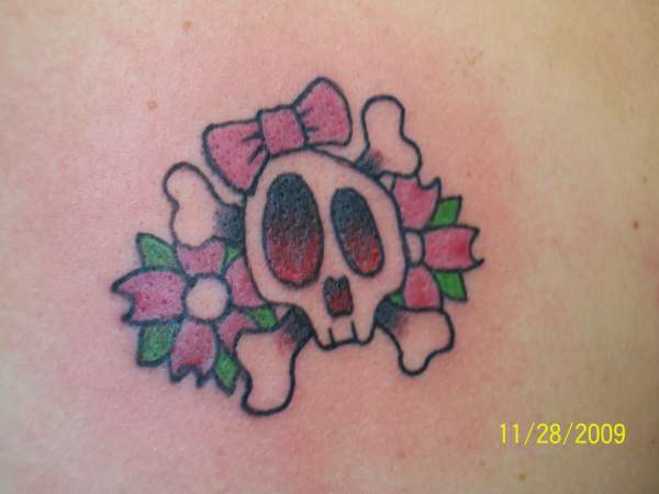 cute skull with flowers tattoo