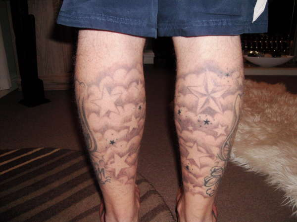 cloud shading on legs tattoo