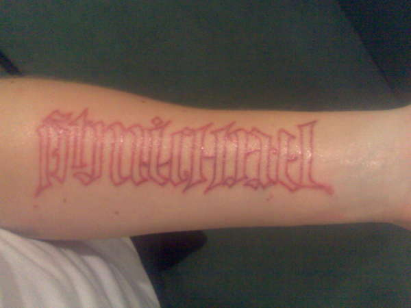 UV Ambigram tattoo