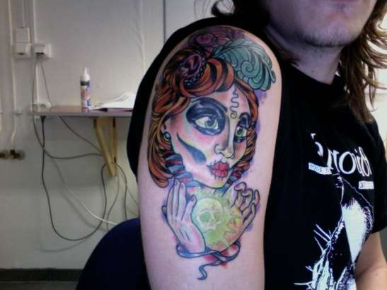gypsy with glowing skull tattoo