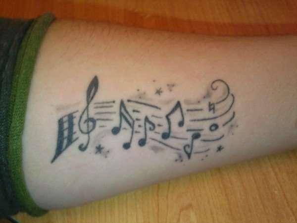 Musical arm tattoo