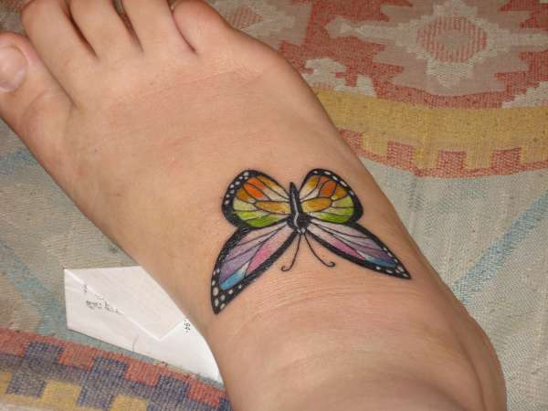butterfly on foot tattoo