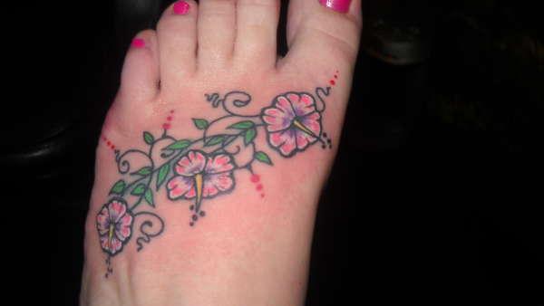 Hibicus vine on my foot tattoo