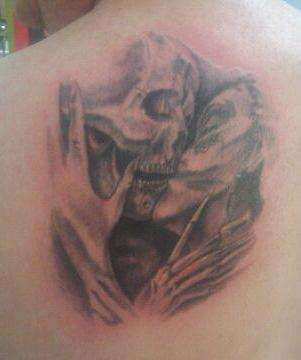 Kissing Skulls tattoo