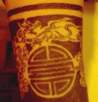 Oriental Ankle Designs tattoo