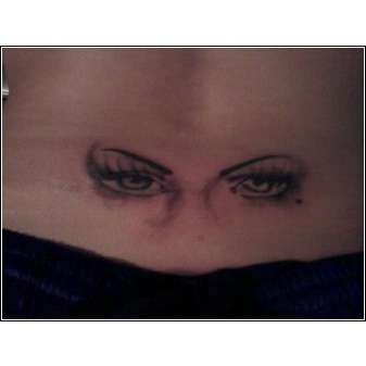 eyes on back tattoo