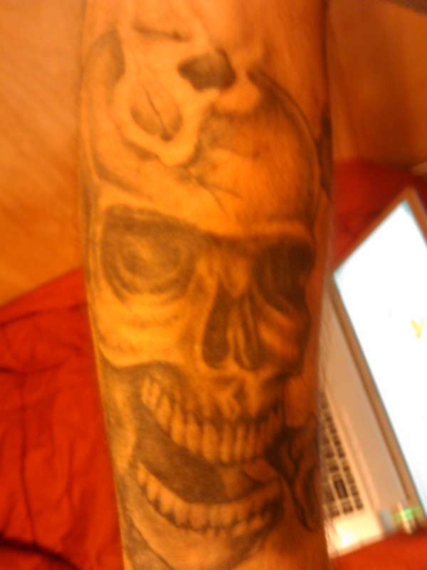 skull (bullet in head) tattoo