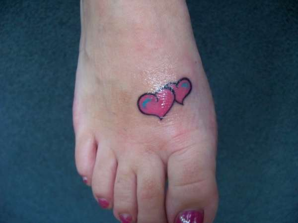 Hearts on foot tattoo