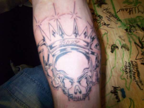 skull head with crown tattoo