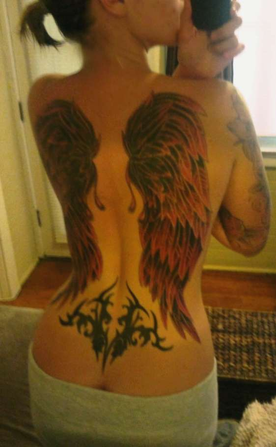 upper and lower back tattoo wings and tribal tattoo