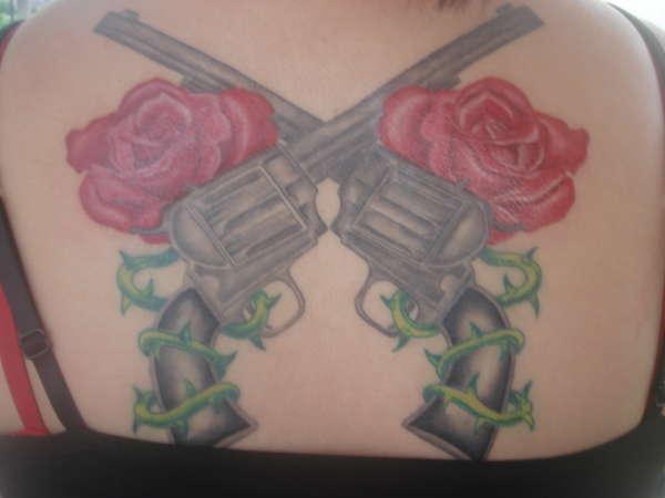back roses n guns tattoo