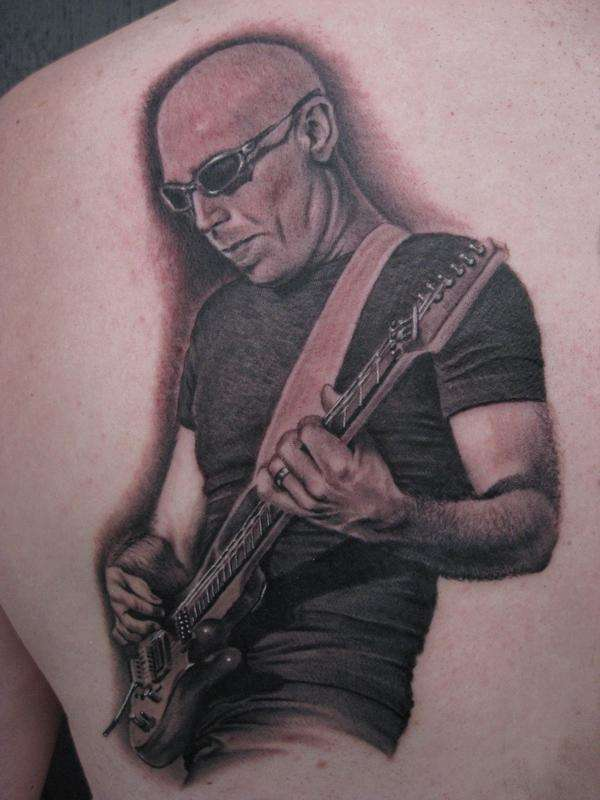 Tattoo By: Bob Tyrrell - Joe Satriani tattoo