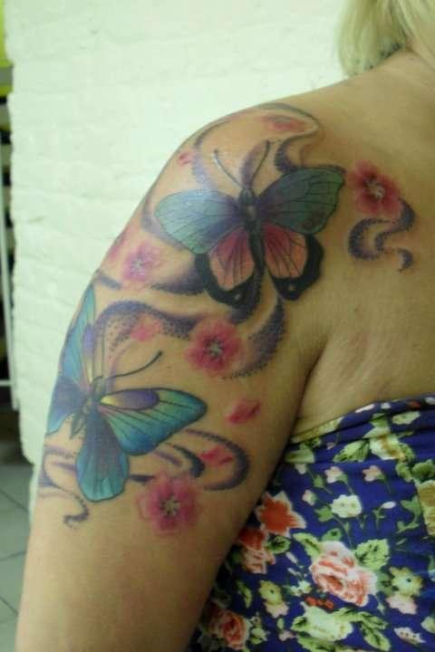 butterflies 3/4 sleeve tattoo