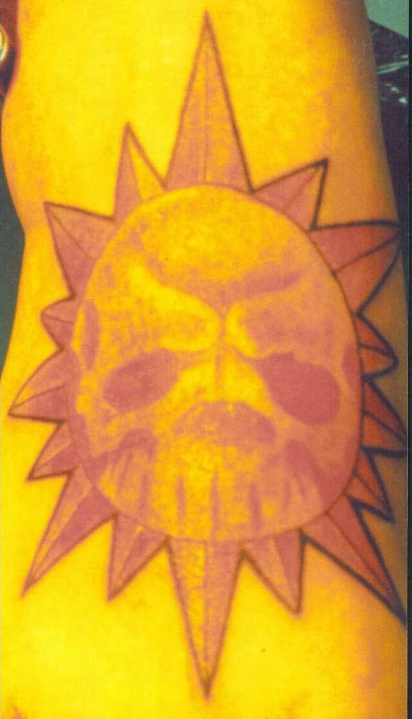 sunskull on foot tattoo