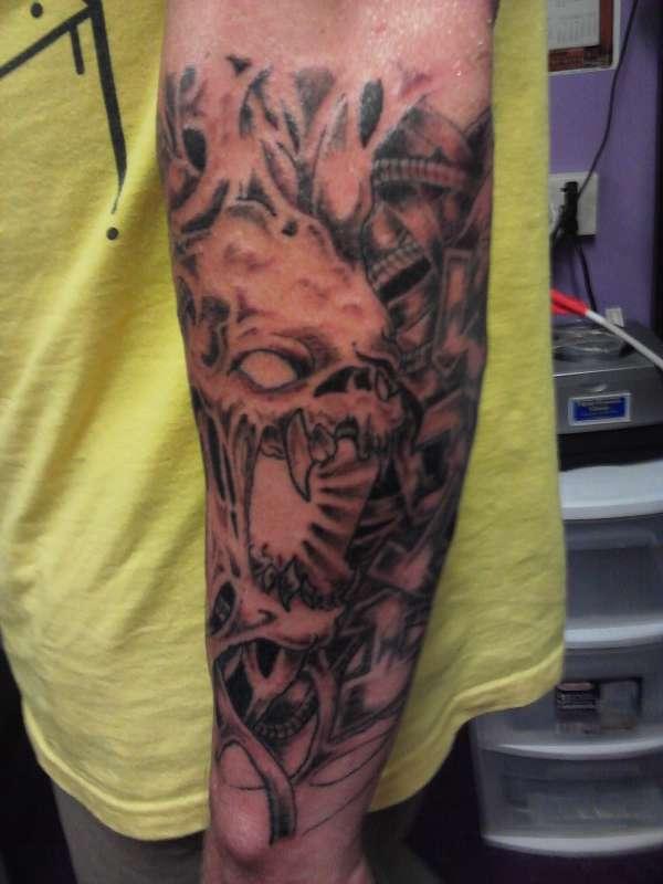 Skull Arm Sleeve Tattoo