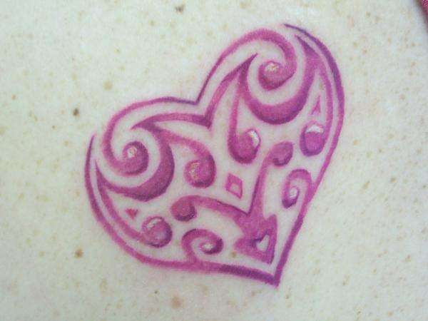 trible heart tattoo