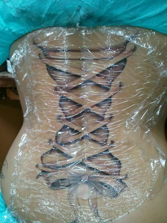 Back Corset tattoo