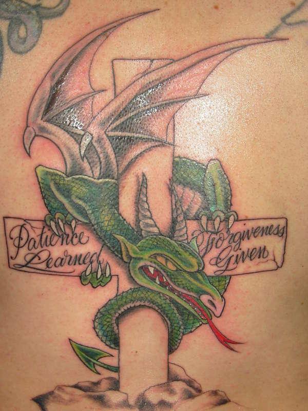 dragon on cross tattoo