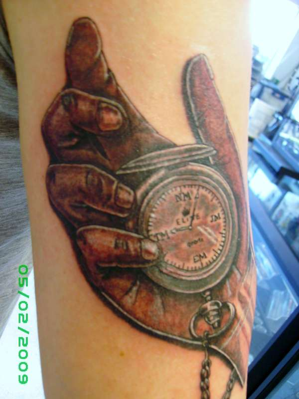 Watch in hand tattoo