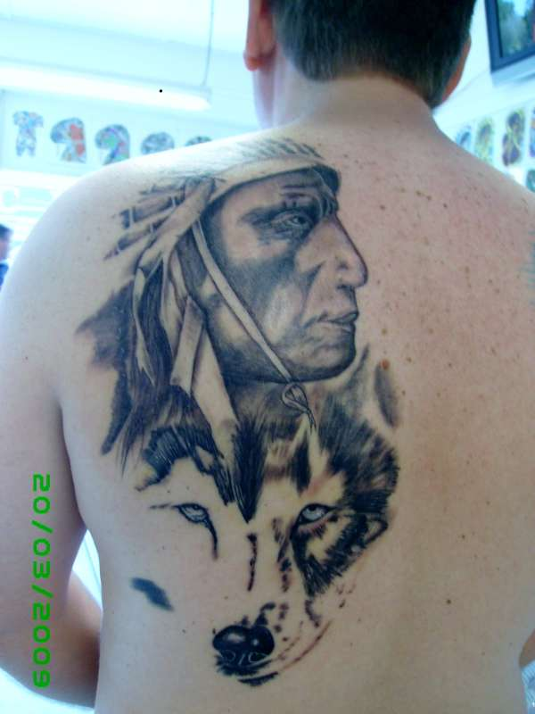 grey wash indian wolf back piece portrait tattoo