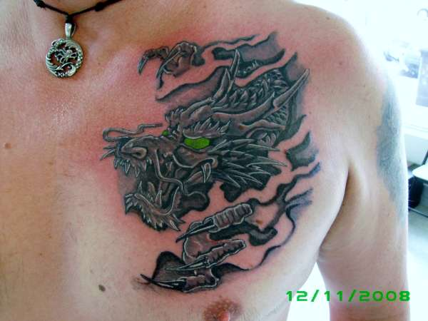Black grey wash dragon on mens chest tattoo for Best soap to clean tattoo