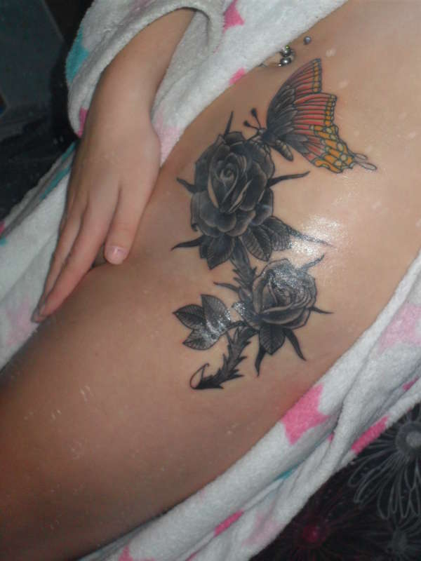 Roses and butterfly tattoo