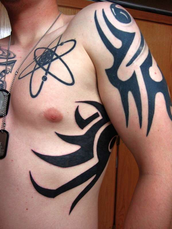 chest ribs and arm tattoo