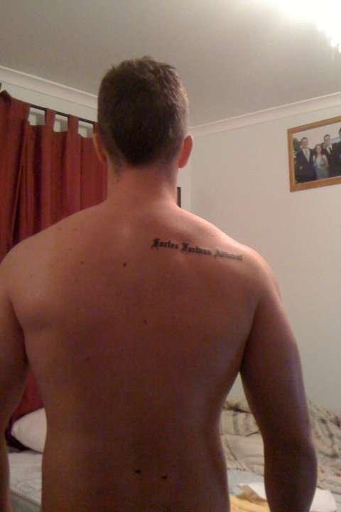 Celebrity rib tattoo