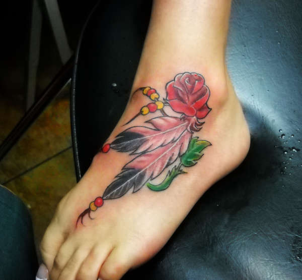 feathers and a rose tattoo