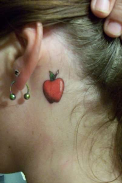 There's an apple behind my ear tattoo