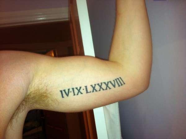 roman numerals 4/9/88 tattoo