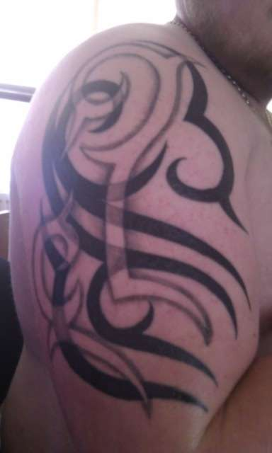 tribal negative and positive tattoo