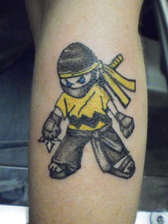 Charlie brown ninja tattoo for Brown tattoo ink cover up