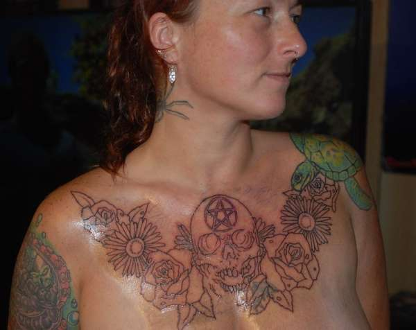 skull & flowers chest outline tattoo