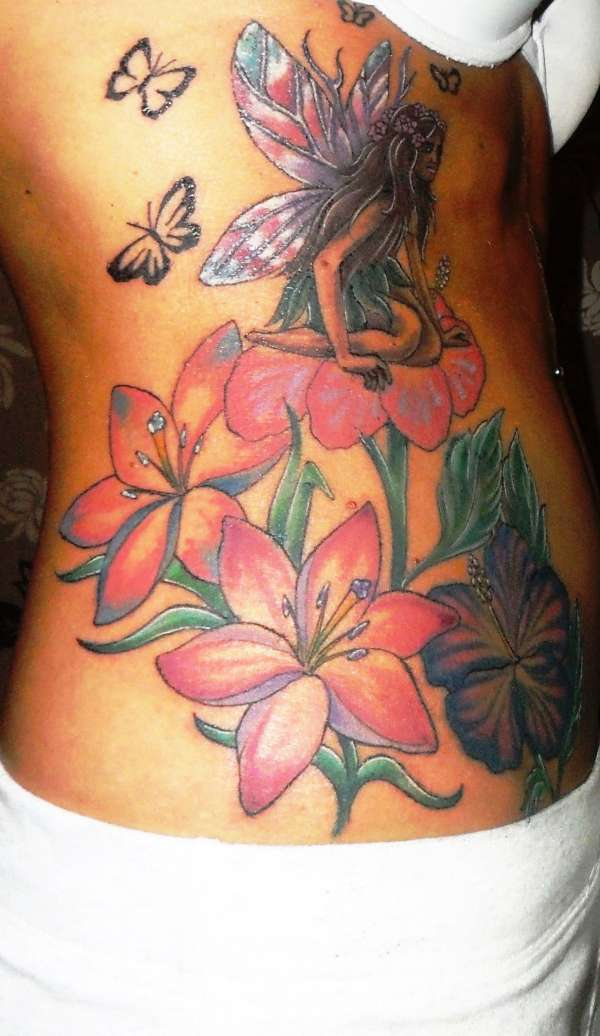 fairies and flowers tattoo