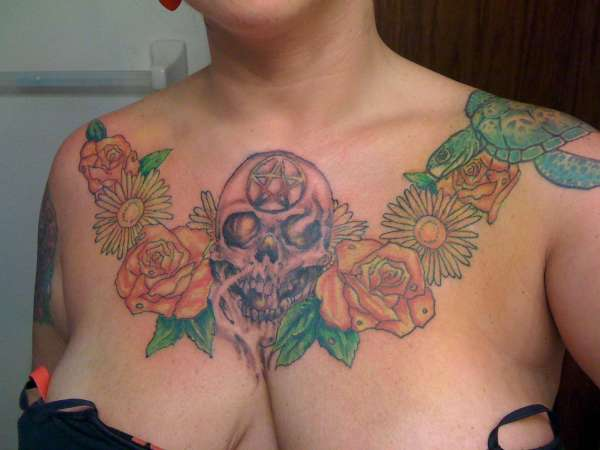 skull & flowers chest colored tattoo
