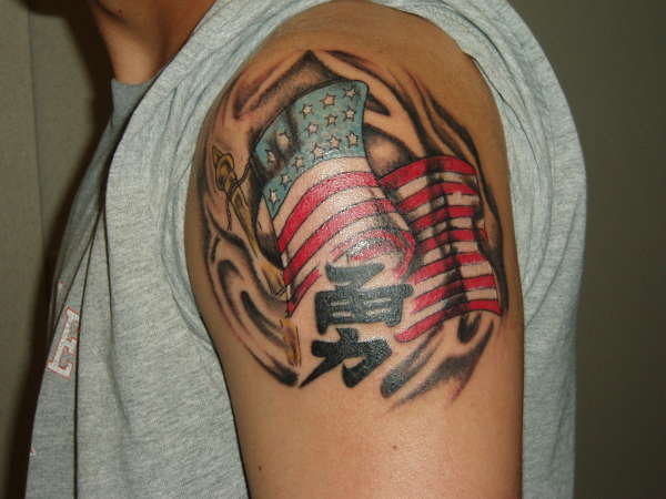 Flag with Courage tattoo