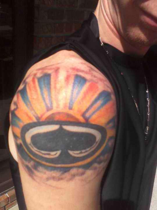 spaded sun tattoo