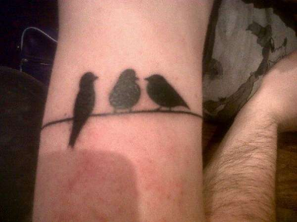 Birds on a wire tattoo