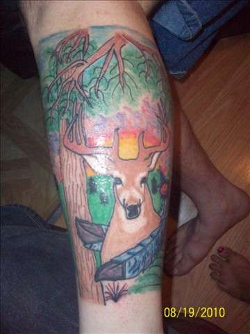 deer and feathers tattoo
