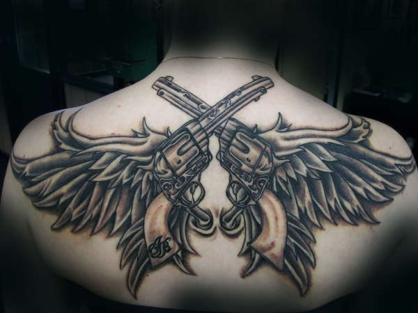 pistols with wings tattoo