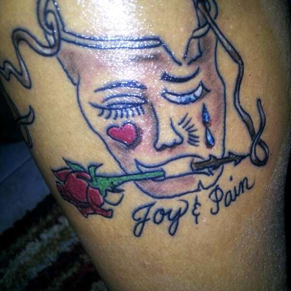 Joy and Pain face cat mask tattoo