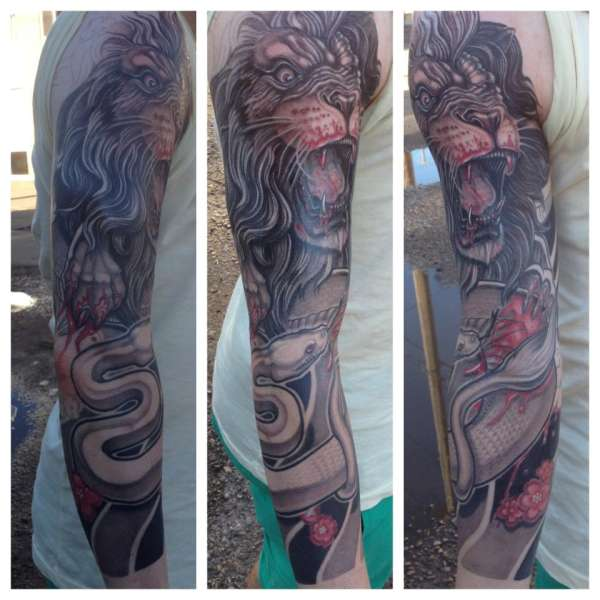 lion fighting snake sleeve tattoo