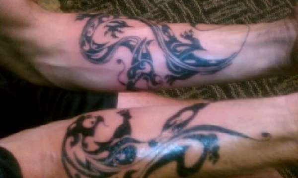Dragon and panther tattoo