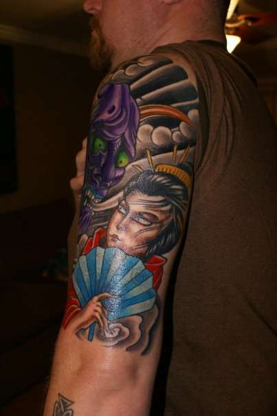 Japanese left arm tattoo