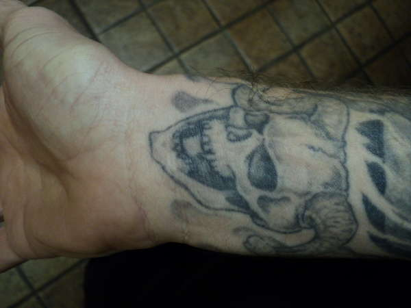 Horned skull tattoo