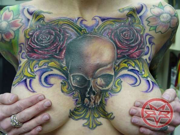 Skull chest piece tattoo for Chest piece tattoos female