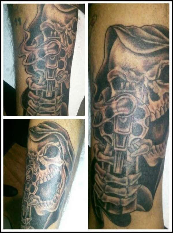 Grim Reaper shooting gun tattoo